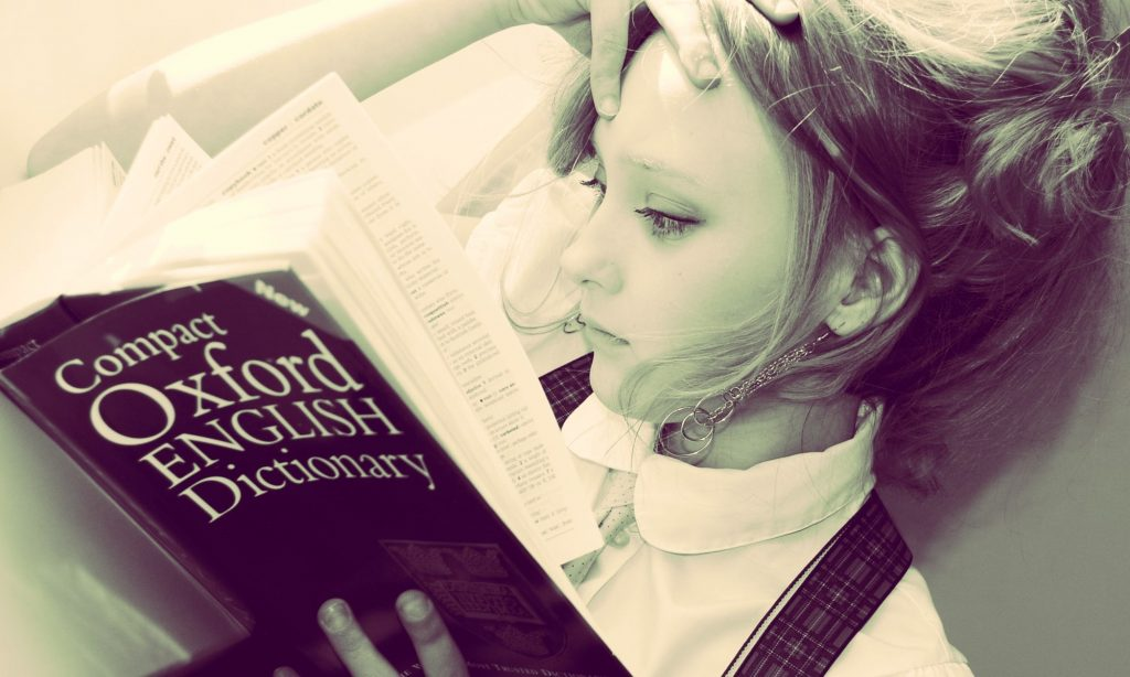 Girl with a dictionary - symbolizing google translate online