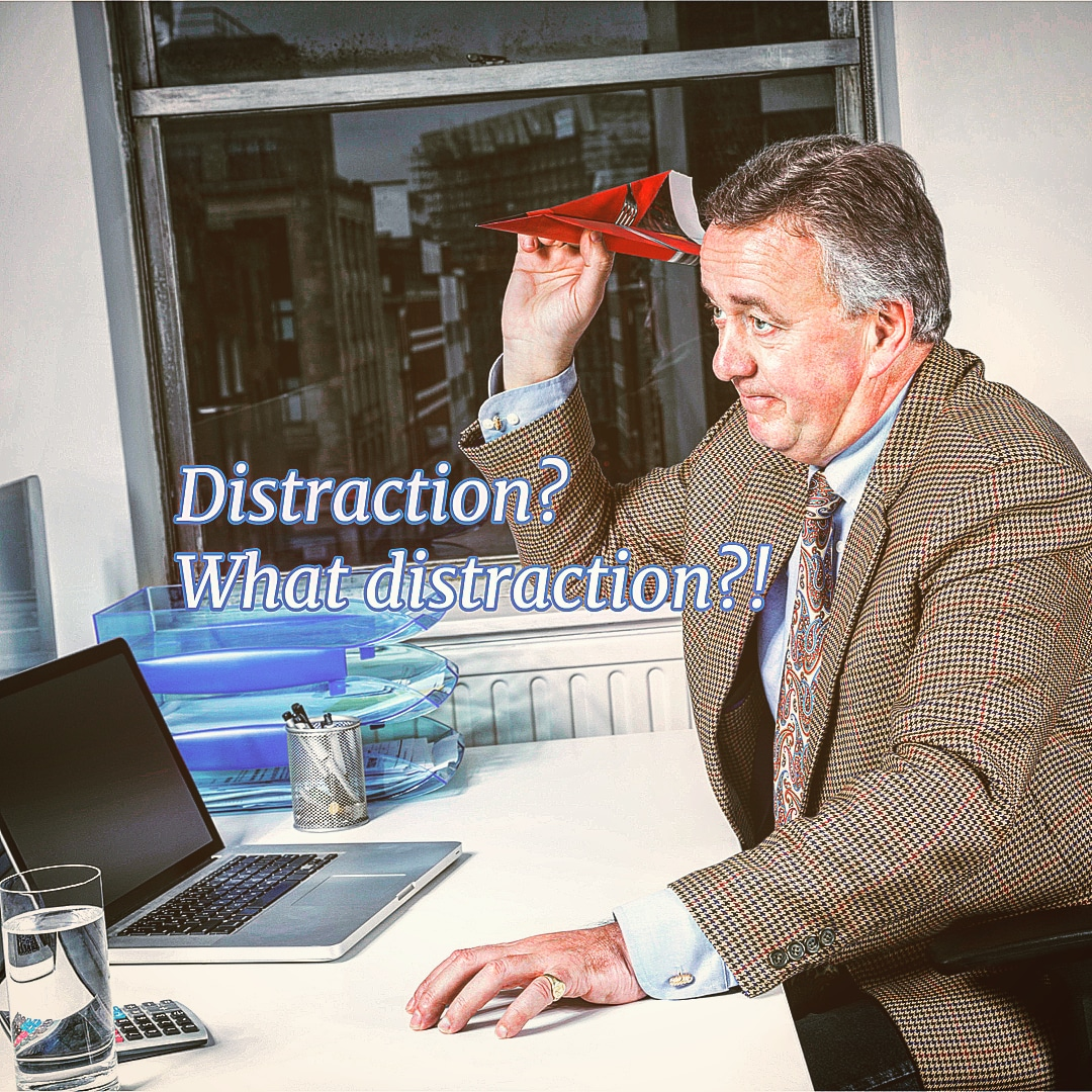 A man near desk - distraction? what distraction?!